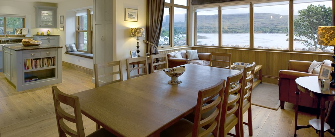 Dine overlooking sea loch, luxury holiday lodge, Shieldaig, Scottish highlands