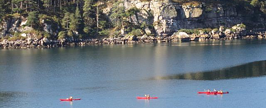 Kayyaking Loch Shieldaig opposite luxury holiday home, Scotland
