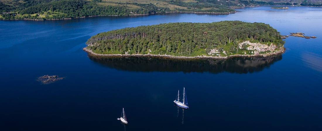 Sailing Shieldaig island opposite luxury holiday house, Scotland